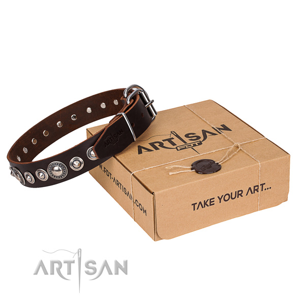 Genuine leather dog collar made of gentle to touch material with rust-proof hardware